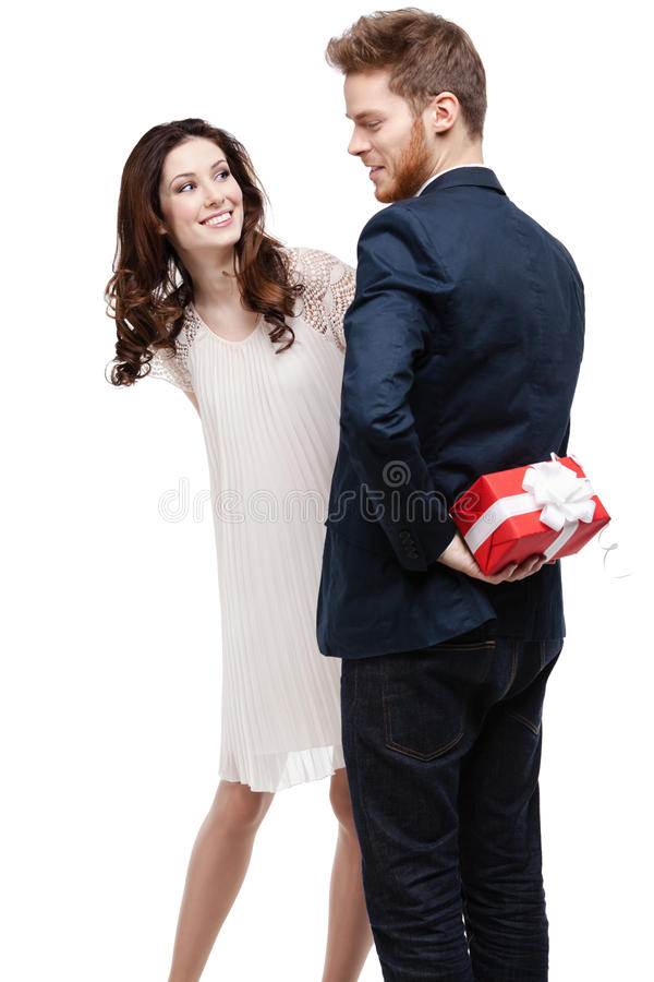 Download Man Conceals The Present Behind The Back Stock Image - Image: 26127455