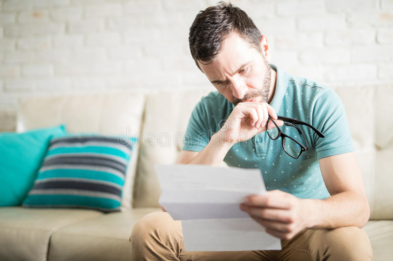 Man concentrated reading a letter royalty free stock image