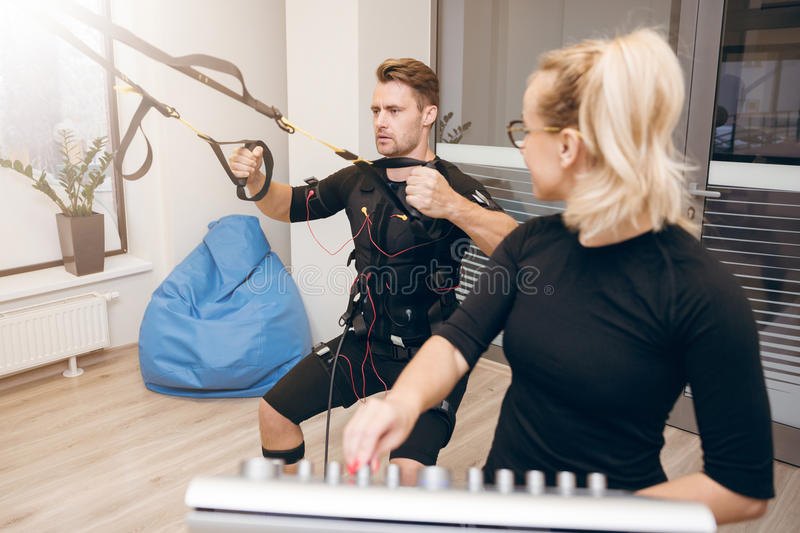 Man concentrated on training and his personal coach looking at h royalty free stock images