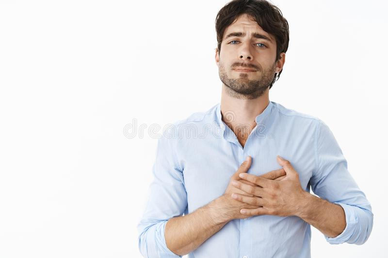 Man confessing in love feeling like heart breaking from one look. Portrait of passionate mature guy with beard and stock photos