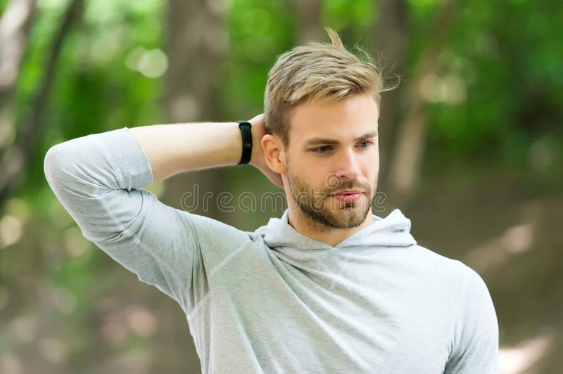 Man confident in his antiperspirant. Guy checks dry armpit satisfied with clean clothes. Sportsman after training. Pleased with antiperspirant. Prevent, reduce royalty free stock photography