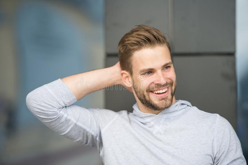 Man confident in his antiperspirant. Prevent, reduce perspiration. No sweat - deodorant works. Guy checks dry armpit royalty free stock photo