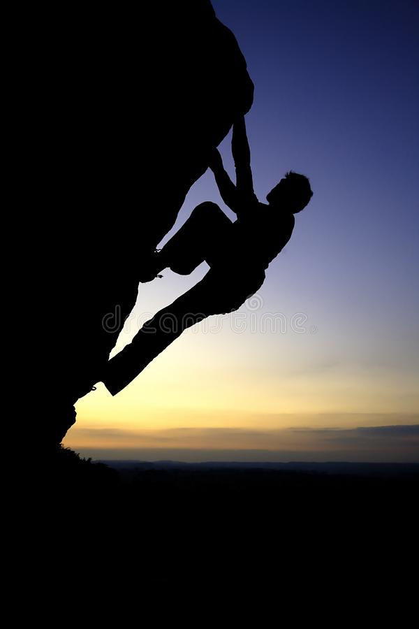 Man conquers mountain royalty free stock photography