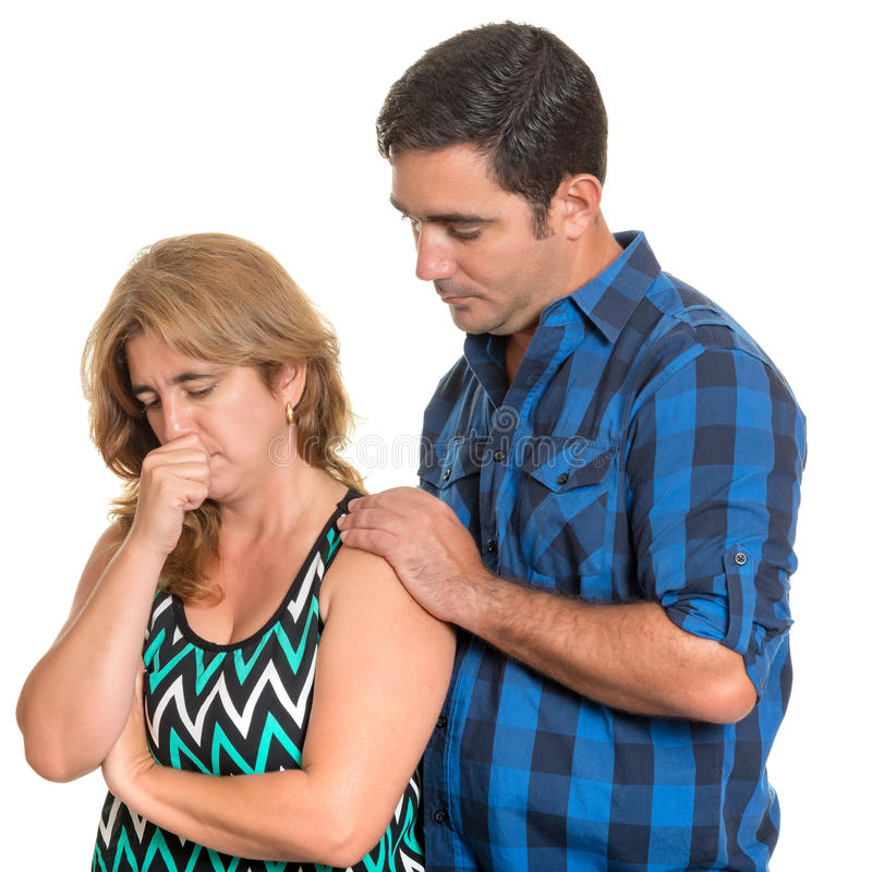 Man consoling her sad wife isolated on white royalty free stock image