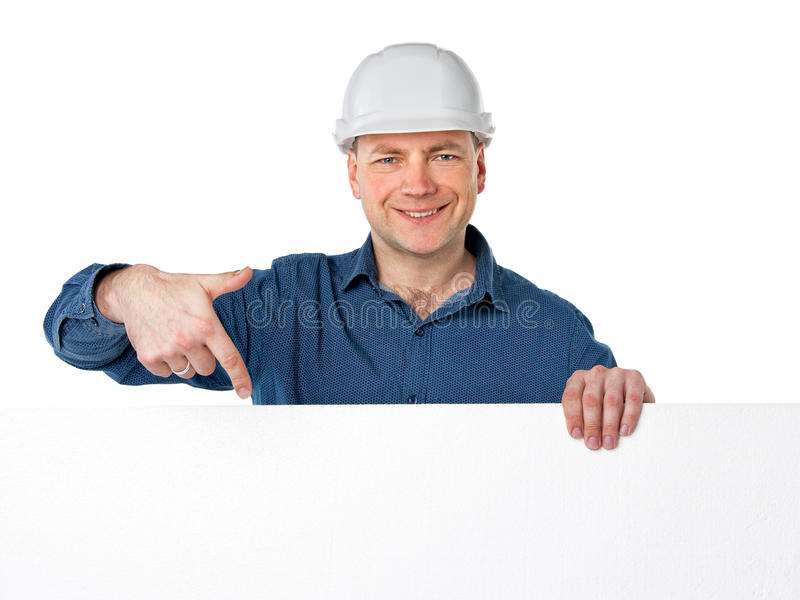 A man in a construction helmet royalty free stock images
