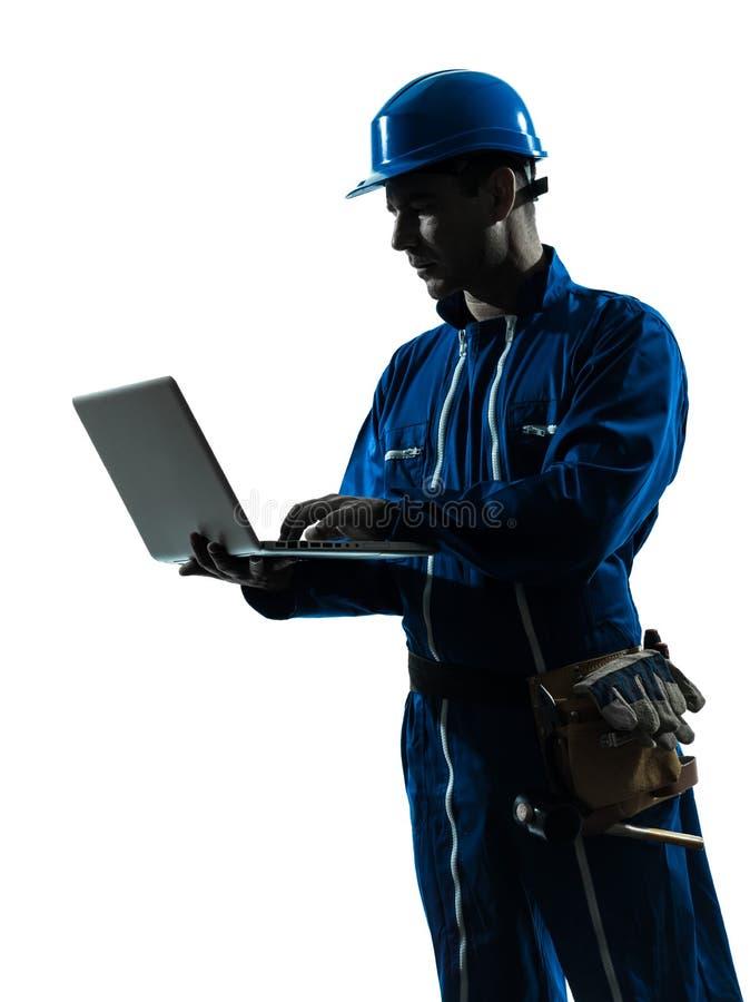 Man construction worker computing computer silhouette portrait stock photo