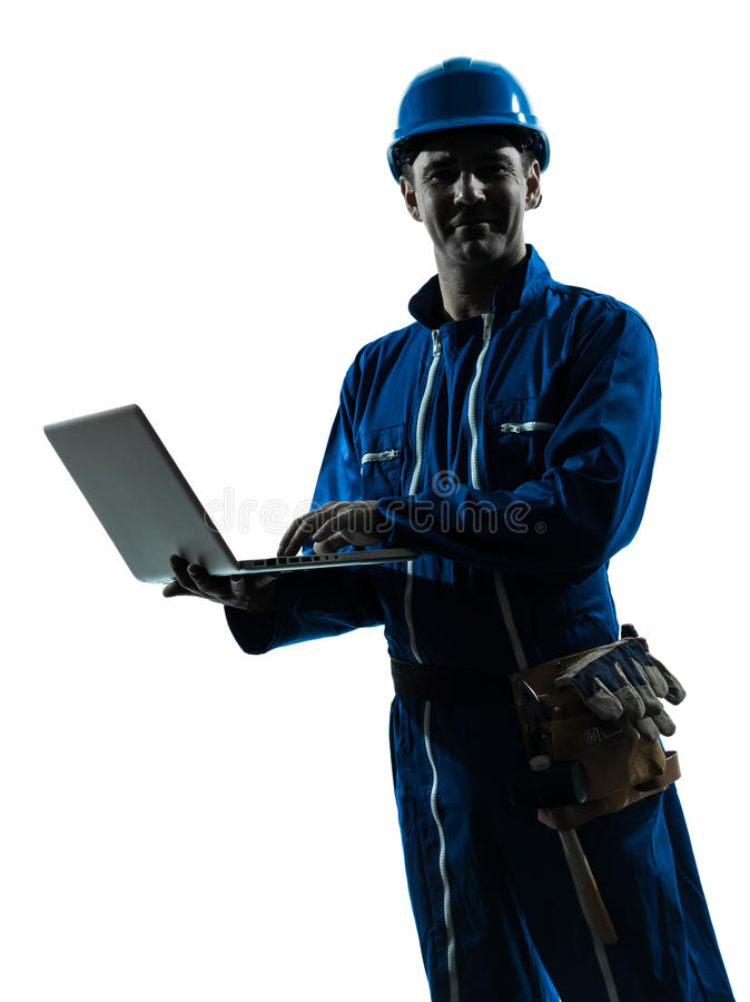 Man construction worker computing computer silhouette portrait. One man construction worker computing computer silhouette portrait in studio on white background stock images