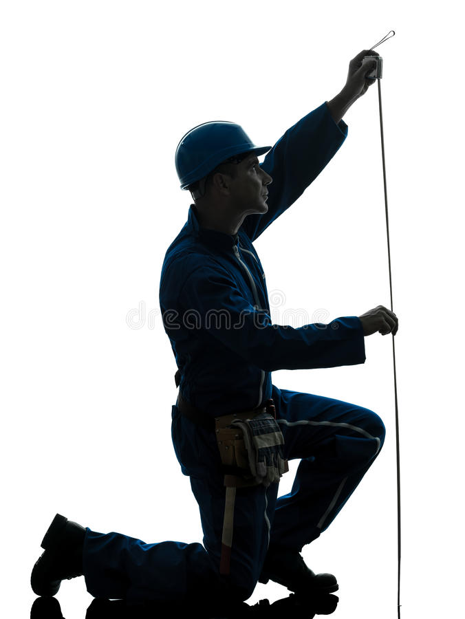 Man construction worker Tape Measure silhouette stock image