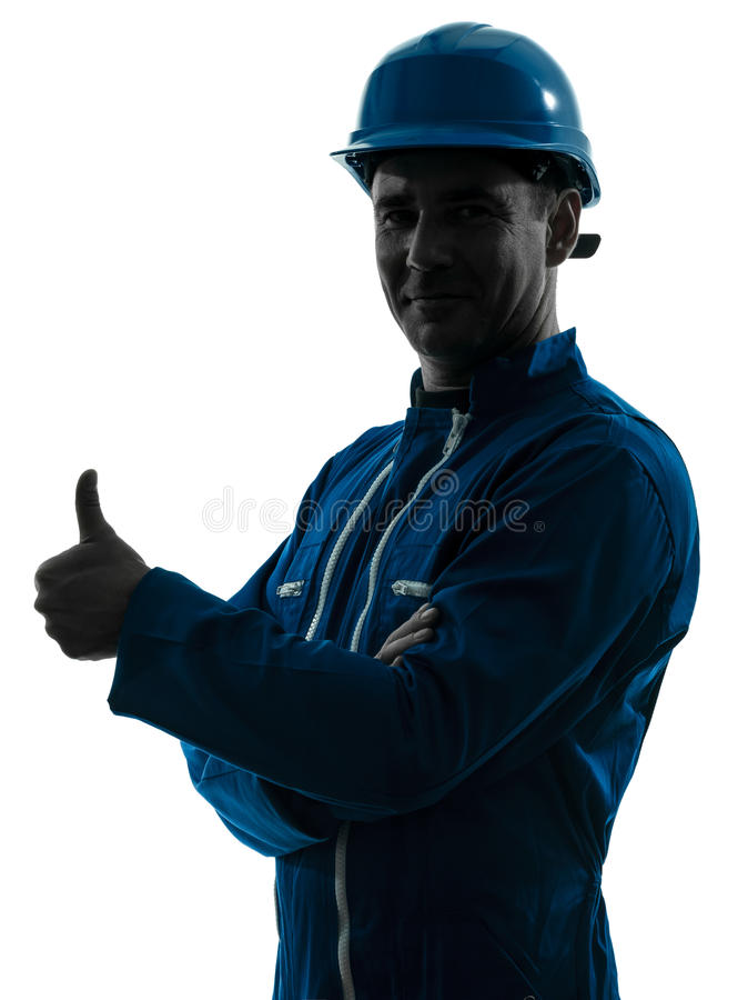 Man construction worker Thumb Up silhouette portrait. One caucasian man construction worker Thumb Up smiling silhouette portrait in studio on white background royalty free stock photography