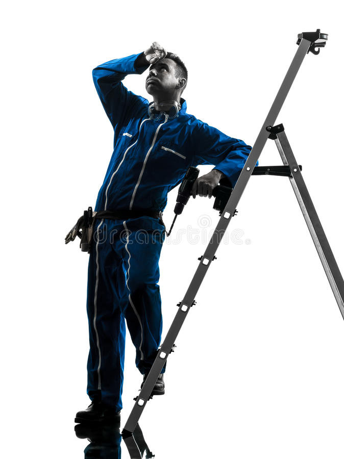 Man construction worker tired sweating silhouette. One caucasian man construction worker tired sweating silhouette in studio on white background stock photo