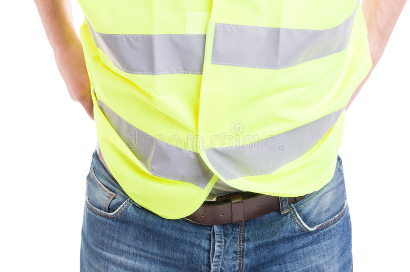 Man constructor in blue jeans wearing reflective safety vest royalty free stock photo