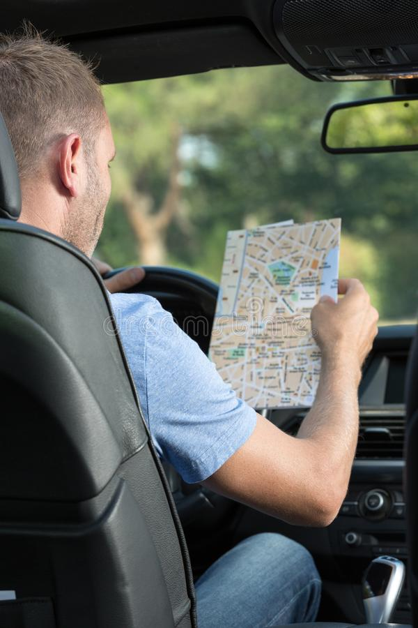 Man consulting paper roadmap royalty free stock image