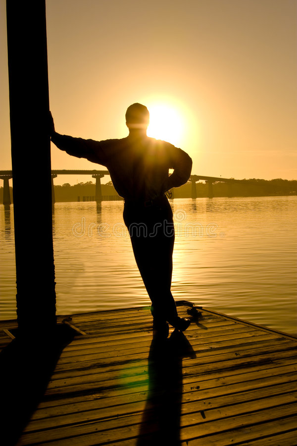 Man in contemplation, sunset stock images