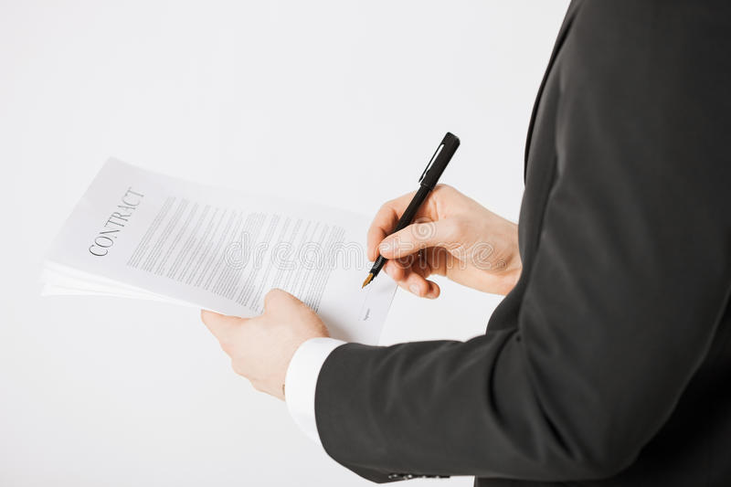 Man with contract. Picture of man hands signing contract with random text stock images