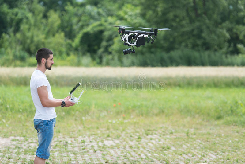 Man Controls Drone in Nature stock photos