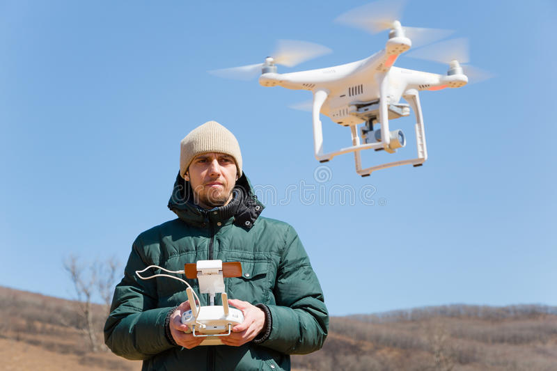 Man controls the flying drones stock images