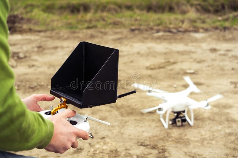 A man controls the quadrocopter control panel stock photo