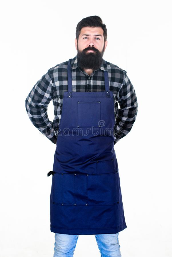 Man cook brutal hipster. Fast food restaurant. Serious bearded cook. Restaurant staff. Ready to cook. Bearded hipster. Wear apron for barbecue. Roasting and stock images