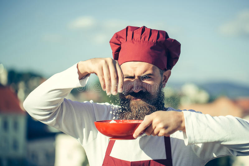 Man cook chef pouring floor stock image