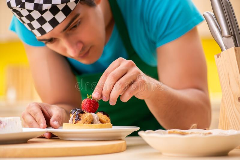 The man cook preparing cake in kitchen at home. Man cook preparing cake in kitchen at home stock image