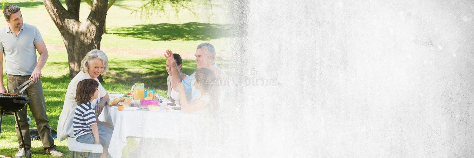 Man cooking bbq for family with white grunge transition stock images