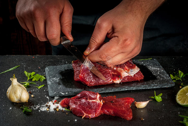 Man cooking beef meat stock images