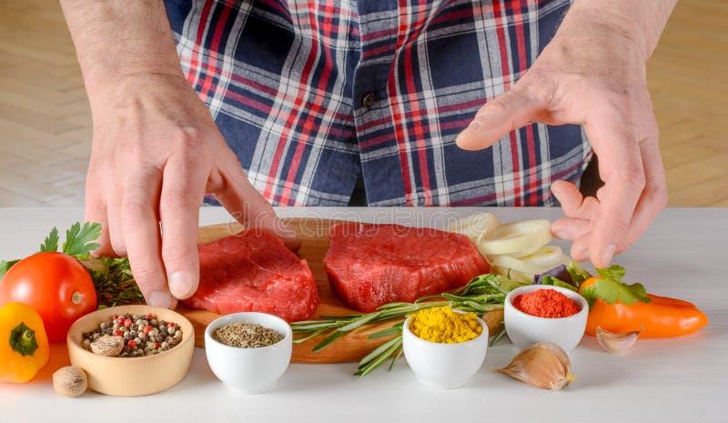 Man cooking beef steaks stock photo