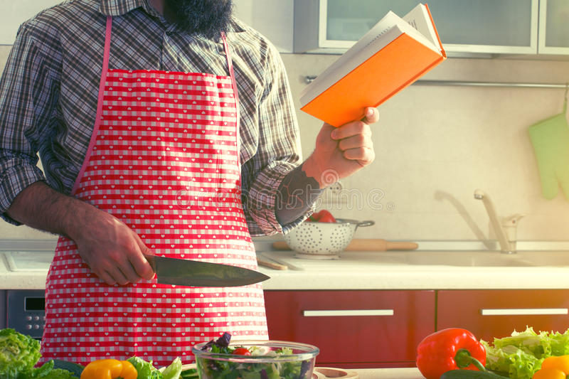 Man cooking healthy salad and reading book stock image image of download man cooking healthy salad and reading book stock image image of healthy green forumfinder Image collections