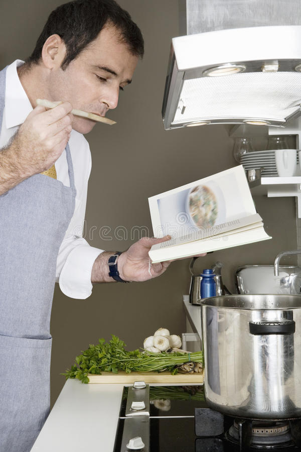 Download Man Cooking at Home stock image. Image of boiling, indoors - 28832175