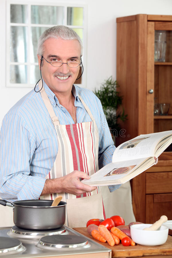 Man cooking meal stock images