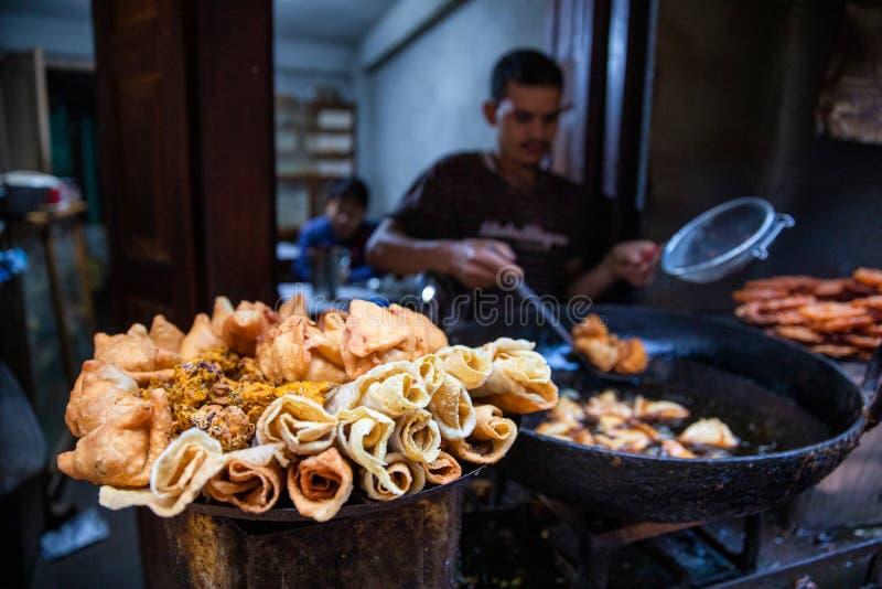 Man cooking Street food Kathmandu royalty free stock images