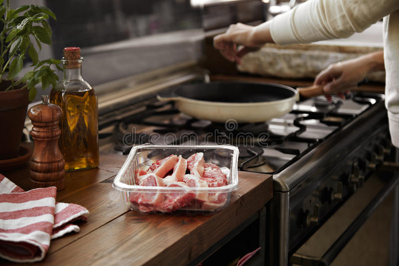 Man cooking steaks royalty free stock photography