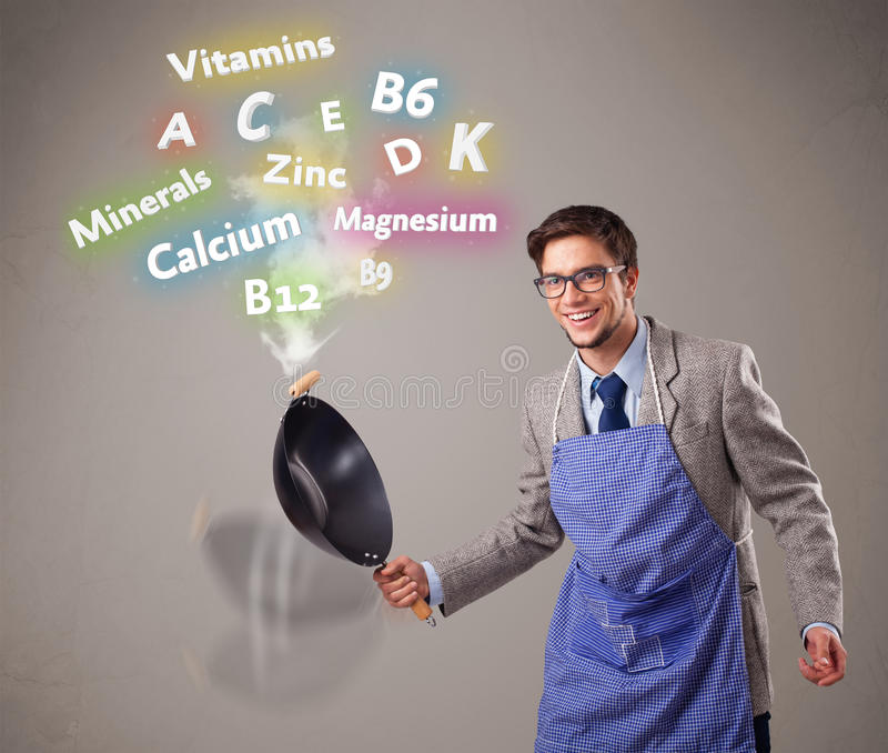 Man cooking vitamins and minerals. Handsome man cooking vitamins and minerals stock photos