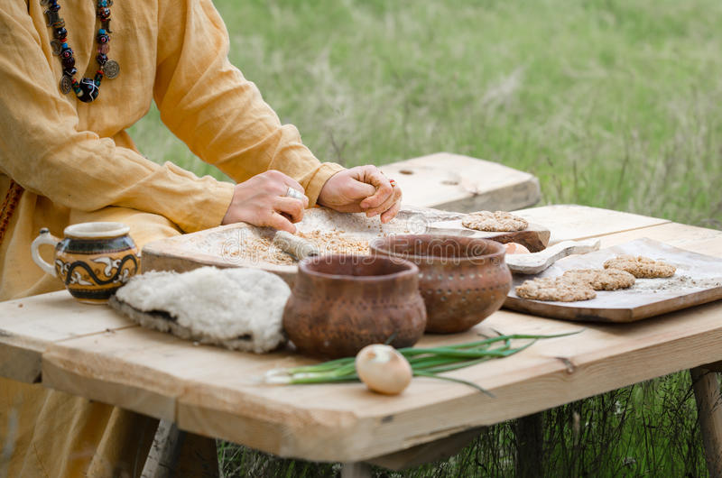 Man cooks bread cakes from whole-grain flour open air with his own hands old traditional recipe past.  stock photo