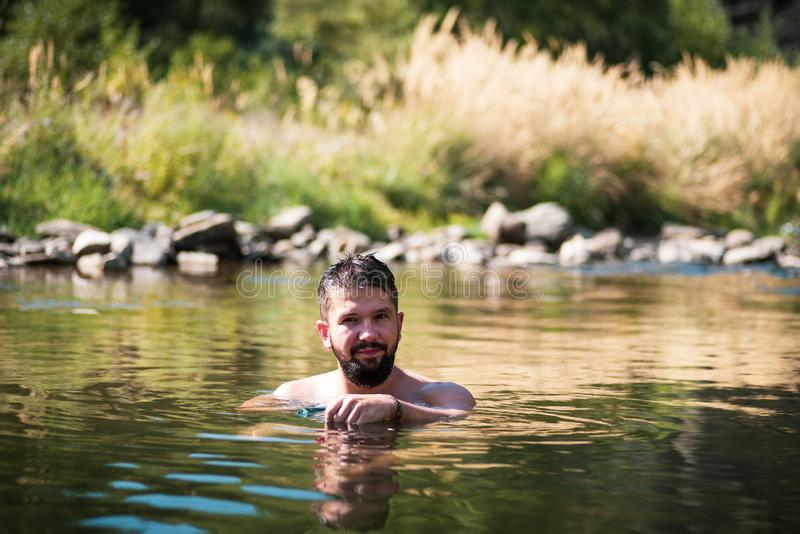 Man cooling down in a river on a summer day stock photography