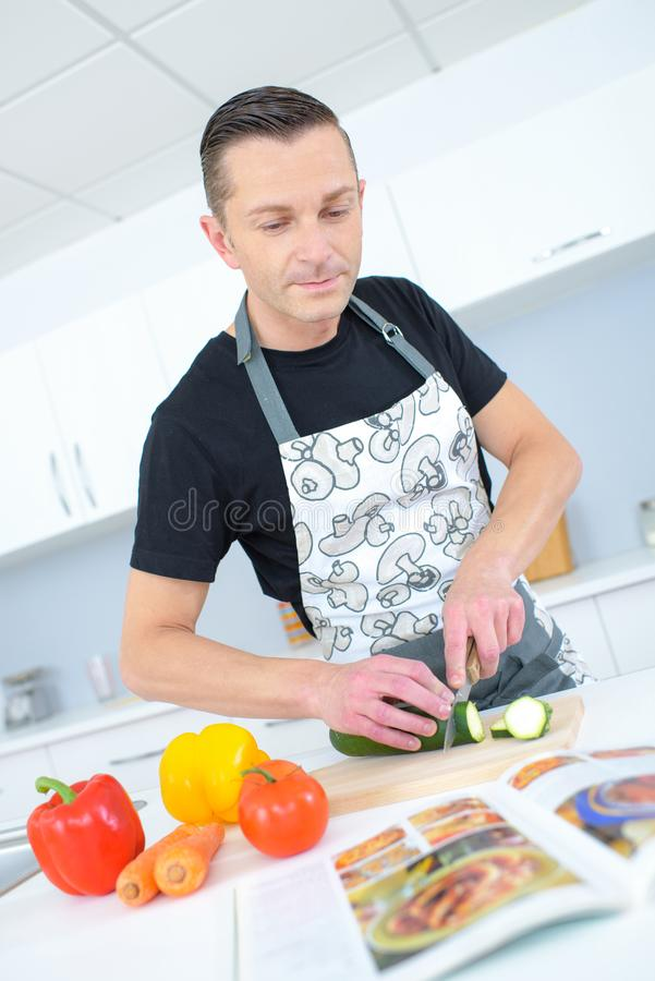Man copying recipe from recipe book stock image image of local download man copying recipe from recipe book stock image image of local kitchen forumfinder Image collections