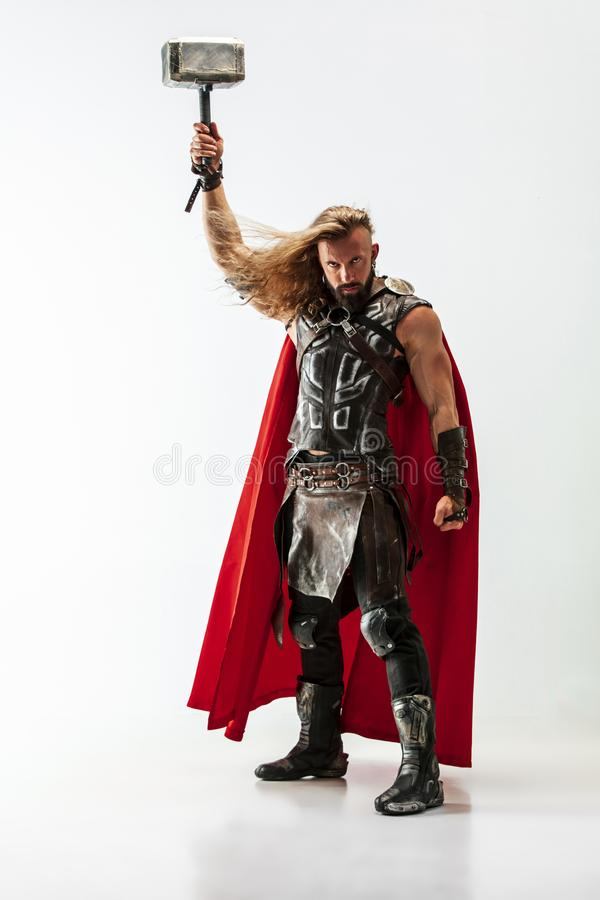 Man in cosplaying Thor isolated on white studio background stock image