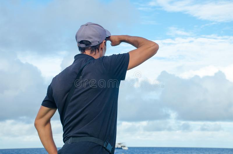 the man costs ashore and looks in the sea royalty free stock photo
