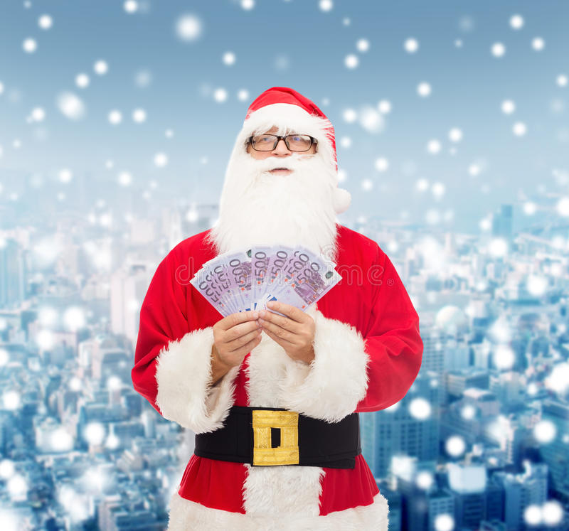 Man in costume of santa claus with euro money royalty free stock photos