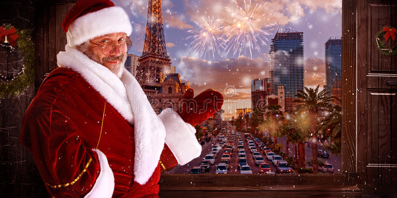 The man in costume of santa claus over night city background royalty free stock image