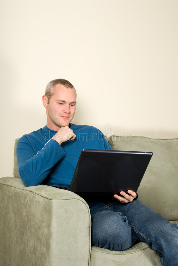 Man on couch stock photography
