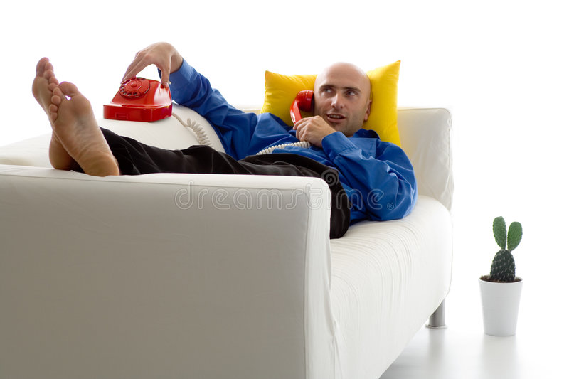 Man On Couch With Phone stock photography