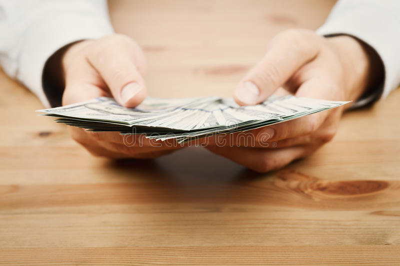 Man count money cash in his hand. Finance, saving, salary and donate concept. Man count money cash in hand. Finance, saving, salary and donate concept stock images