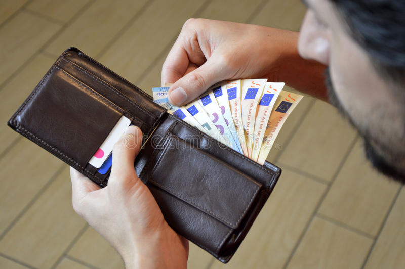 Man counting his money in the leather wallet euro stock photo