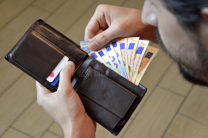 Man counting his money in the leather wallet euro stock images