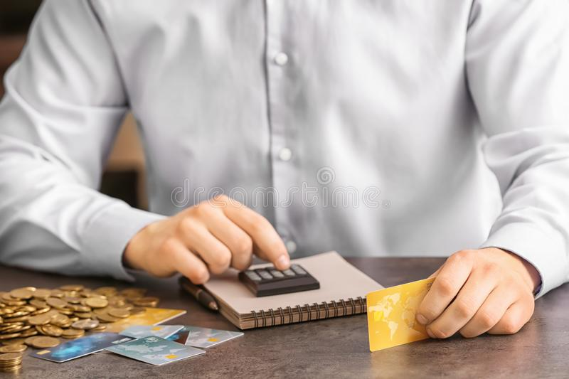 Man counting income at table. Savings concept stock photos