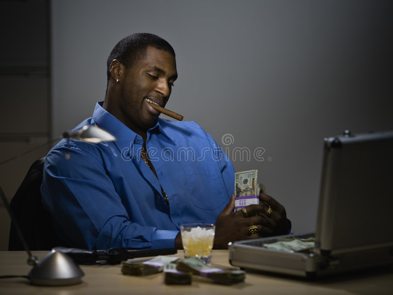 Man counting money at desk royalty free stock photos