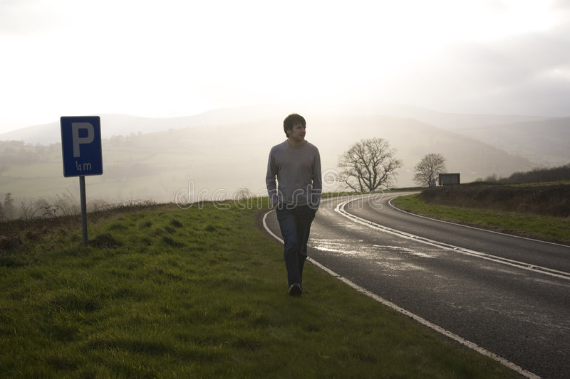 Man On Country Road. Man Walking On Country Road royalty free stock photo