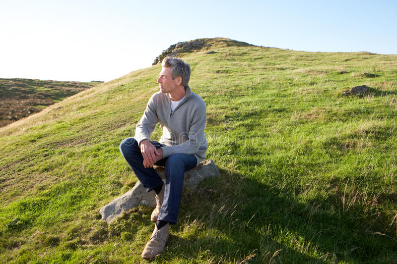 Man in countryside. Looking off camera royalty free stock image