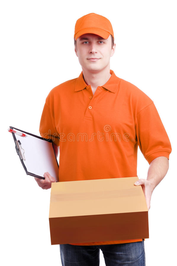 Man courier in orange. Young man courier in orange holding a box isolated on white royalty free stock photo